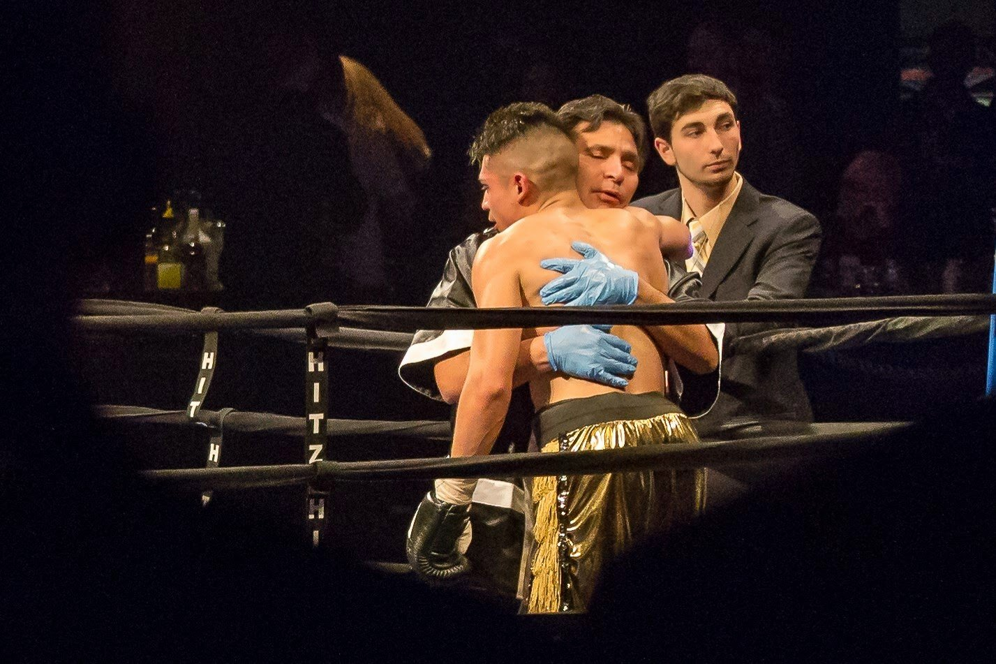 Father, Guillermo Coix, hugs his son, Will Coix, after winning a fight at a Hitz Boxing event.